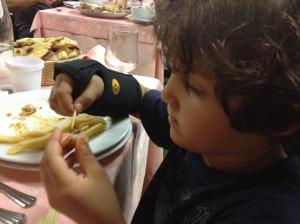 """Dissecting """"lumache di mare"""" at a seaside restaurant in Giulianova in Abruzzo"""