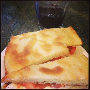 Torta al testo with tomatoes and fresh mozzarella