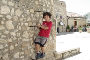 My son Stefano climbing the walls of Santo Stefano