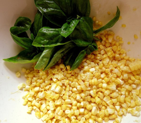 The addition of corn and basil makes this soup summery