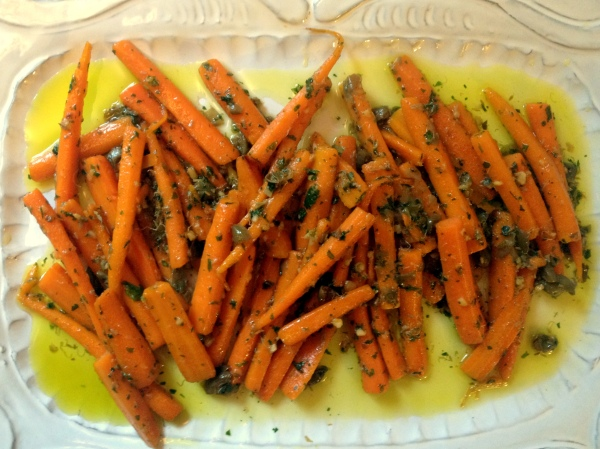 "Sweet carrots slowly braised in olive oil and a bit of water and finished off with salty capers - I call these, ""carrots, elevated"""